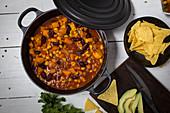 Sweet potato chili with avocado and nachos