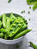 Fresh green peas in the bowl