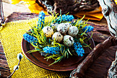 Fresh eggs with flower on plate
