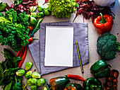 Notebook with fresh vegetables