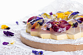 Unique japanese dessert Havaro of jelly and bavarian cream with edible violet flowers