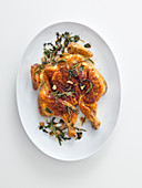 Fried poussin with chili and fresh herbs