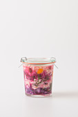 Preserved white and red cabbage with orange peel, anise and dill