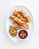 Pork and ginger skewers with spicy beetroot sauce