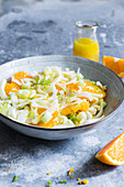 A plate with a salad with oranges, fennel and celery, dressed with orange vinaigrette