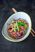 Chinese wonton noodles with green asparagus and red wine infused onions