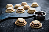 Vegan tower biscuits filled with blackcurrant jam