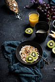 Muesli with fresh fruits, juice and almond milk