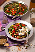 Green lentils, cucumber, kale and baked pepper salad with feta