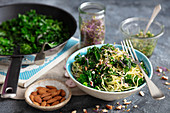 Spaghetti with almond pesto and fried kale