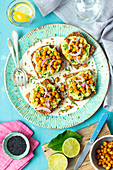Wholemeal bread with guacamole, baked chickpeas and red onion