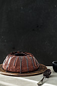 Chocolate donut cake in front of a black background