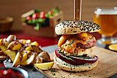 Delicious gourmet burger with patty, onion and cheese served with potato wedges