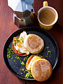 Toastie sandwiches with fried eggs and tomatoes for a late breakfast