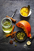 Ingredients for making winter punch with spices, pineapple and pumpkin