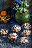 Buns with roses from apples, sprinkled with powdered sugar