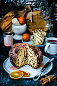 Babka with cinnamon, poured pink icing