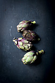 Poveraden (baby artichokes) on a dark background