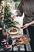 A table laid in a garden with fig tarts and coffee