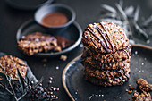 Gluten-free millet biscuits with chocolate coating and sea salt