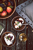 Pavlova with whipped cream and spiced plums in cider