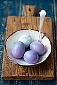 Purple hard-boiled eggs with red cabbage cooking water
