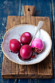 Hard-boiled eggs dyed red with beetroot juice