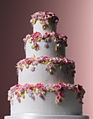 Easter Celebrations, tiered white wedding cake with tumbling sugared flowers