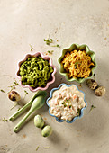 Three savoury spreads with quail's eggs and spoons