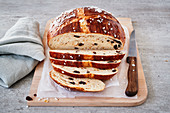 Hot Cross Bun loaf with raisins and sugar nibs, sliced