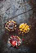Belgian waffles with various sweet toppings