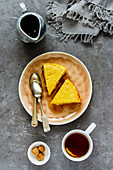 Sweet breakfast with soft homemade cottage cheese cake, maple syrup and tea cup