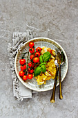 Flat-lay of fried potato in plate over grey concrete table background