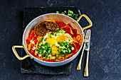 Shakshuka Fried eggs and tomatoes in frying pan
