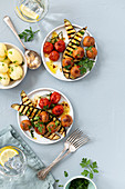 Vegan 'meatballs' with grilled vegetables and potatoes