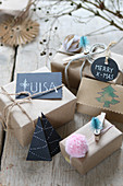 Wrapped Christmas gifts with name tags