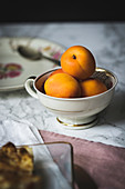Fresh apricots in a porcelain cup