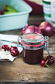 Homemade cherry chutney in a flip-top jar