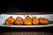 Chicken tikka (curried chicken, India)