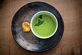 Herb soup with cheese gnocchi