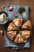 A light pizza with buffalo mozzarella, radicchio and anchovy pesto