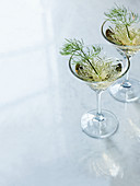 Fennel wine in stemmed glasses