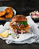 A chicken burger with coleslaw