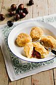 Damson dumplings on an enamel plate