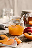 Apricot jam in jar with spoon