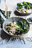 A 'Donburi' rice salad bowl with algae, avocado and nori