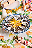 Oysters with lemons on a colorful Christmas table