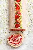 Strawberry and cream Swiss roll with pistachios