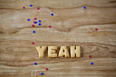 Biscuits letters and confetti