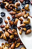 Roasted cashews, peanuts, almonds and dried cranberries in asian nut mix